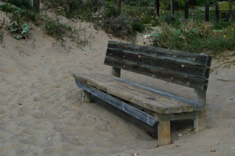 wooden bench in sand