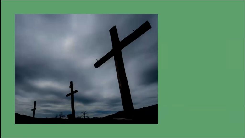 Three crosses under an overcast sky.